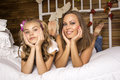 Mother and daughter lying on the bed. Royalty Free Stock Photo