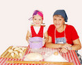 Mother and daughter make rolls with flour Stock Photo