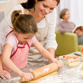 Mother and daughter making apple tart together Stock Photography