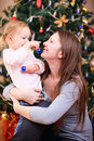 Mother and daughter near Christmas tree Royalty Free Stock Photos