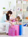 Mother with daughter openning purchase Stock Photo