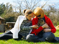 Mother and daughter pet a dog Stock Photo