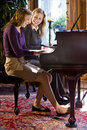 Mother and daughter piano duet Royalty Free Stock Photography