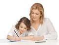 Mother and daughter picture of doing home work Stock Photography