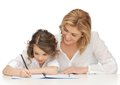 Mother and daughter picture of doing home work Stock Images