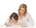 Mother and daughter picture of doing home work Stock Photo