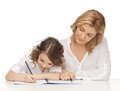 Mother and daughter picture of doing home work Stock Image