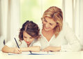 Mother and daughter picture of doing home work Stock Photos