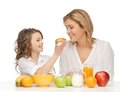 Mother and daughter picture of with healthy breakfast Royalty Free Stock Photos