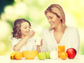 Mother and daughter picture of with healthy breakfast Stock Image