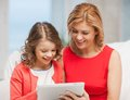 Mother and daughter picture of with tablet pc Royalty Free Stock Photo