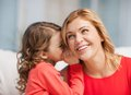 Mother and daughter picture of whispering gossip Stock Photography
