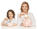 Mother and daughter with piggy banks paper money Stock Photo