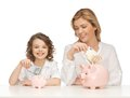 Mother and daughter with piggy banks paper money Stock Photography