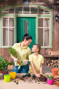 Mother and daughter with plants and flowerpots standing