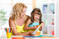 Mother and daughter play doing handcraft Royalty Free Stock Photo