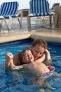 Mother and daughter playful in the pool showing her trust to with her bodya hands Royalty Free Stock Image