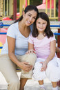 Mother and daughter in playground Royalty Free Stock Photography
