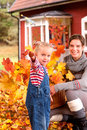 Mother and daughter playing in autumn leaves Royalty Free Stock Photos