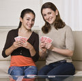 Mother and Daughter Playing Cards Royalty Free Stock Photo