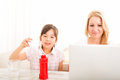 Mother and daughter playing at home the table Royalty Free Stock Photography