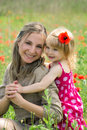 Mother and daughter in poppy field Stock Photo