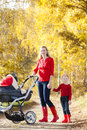 Mother and daughter with a pram Royalty Free Stock Photography