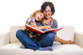 Mother and daughter reading funny things little girl having fun or in big album or red book at home Royalty Free Stock Images