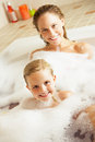 Mother And Daughter Relaxing In Bubble Filled Bath Royalty Free Stock Photo