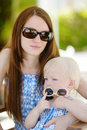 Mother and daughter relaxing in outdoor restaurant toddler Stock Photography