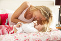 Mother And Daughter Relaxing Together In Bed Royalty Free Stock Image
