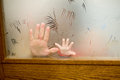 Mother and daughter s hands daugther hand behind door window Royalty Free Stock Photography