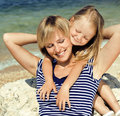 Mother with daughter at sea cost together, happy real family Royalty Free Stock Photo
