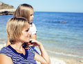 Mother with daughter at sea cost together, happy real family smiling looking to horizont, lifestyle people concept, on Royalty Free Stock Photo