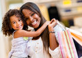 Mother and daughter shopping portrait of a looking happy Stock Images