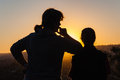 Mother daughter silhouetted sunset watch the Stock Images