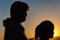 Mother daughter silhouetted together watch the sunset Royalty Free Stock Photography