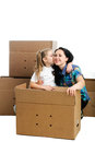 Mother and daughter sitting between cardboard boxes Royalty Free Stock Photo