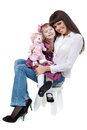 Mother and daughter sitting on a chair Stock Images