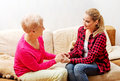Mother and daughter sitting on couch and holding hands Royalty Free Stock Photo