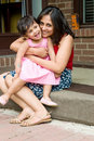 Mother and daughter sitting at the doorstep Royalty Free Stock Images