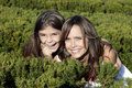 Mother and daughter smiling in bushes Stock Images