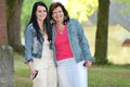 Mother and daughter smiling family portrait in the park Royalty Free Stock Photography