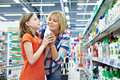 Mother and daughter sniff fragrance shampoo in supermarket Royalty Free Stock Images