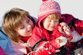 Mother and daughter in snow Stock Photos