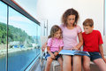 Mother, daughter and son carefully review book Stock Photo