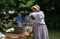 Mother daughter stir lemonade heston civil war days reenactment heston dressing period costumes people camp out show how life was Royalty Free Stock Photography