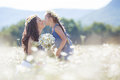 Mother and daughter in summer field of blooming daisies Royalty Free Stock Photo