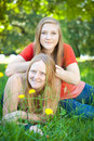 Mother and daughter in summer nature green shallow dof mothers face focus Stock Images