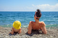 Mother and daughter sunbathe on the beach Royalty Free Stock Photo